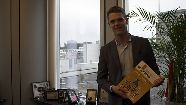 MEP Christofer Fjellner with the fourth issue of our magazine
